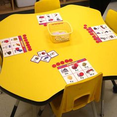 """INSTRUCTION: CTW (2016) states that students learn better when they are presented with engaging activities, such as games. This activity motivates students to practise their letters and sounds through a modified version of """"Bingo."""" One student calls out letters/sounds, and the other players will place a counter down if they have it. The goal is to fill up their board. Students continually practise their letters/sounds throughout the game as they must recognize them in order to play."""