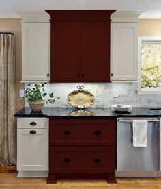 Accent your kitchen with painted cabinets. The accent here is CliqStudios Garnet paint on the Rockford kitchen cabinet door style.