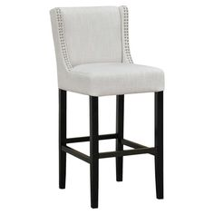 Perfect pulled up to your kitchen island or breakfast table, this chic stool showcases a wingback silhouette and nailhead trim.   Pr...