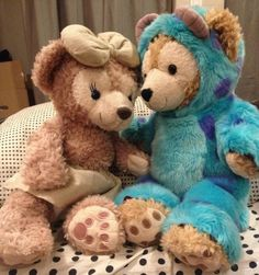 """ShellieMae snuggles up to Duffy the Disney Bear in a """"Sully"""" costume, from Disney's """"Monsters Inc""""."""