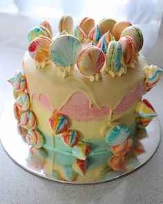 Show stopper 3 tear cake with French Macaron and colourful meringue
