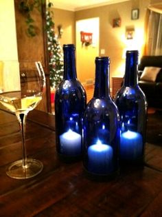 Blue wine bottle candle table lanterns     http://indulgy.com/post/JFItqOAEB1/hanging-wine-bottle-lanterns#