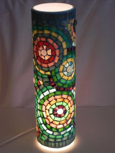 Stained glass mosaic tea light holder in purple and gold