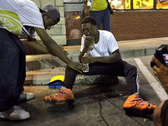 """My word!!!!! RT""""@jdeloma: RT @alexwroblewski Protesters in #Ferguson after getting hit by tear gas from police"""