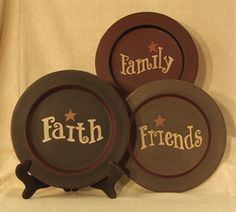 Faith, Family, Friends plates in the kitchen above the cabinets