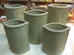 these clay pieces have such tasty detailing! stamped slab vases: firewhenreadypottery.com