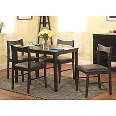 @Overstock.com - Wesley 5-piece Black Dining Set - Perfect for a breakfast nook or small dining area, this five-piece black dining set gives you traditional style with contemporary comfort. The rubberwood and black vinyl set offers your room a modern look that fits well with most modern decor.  http://www.overstock.com/Home-Garden/Wesley-5-piece-Black-Dining-Set/5254391/product.html?CID=214117 $215.99