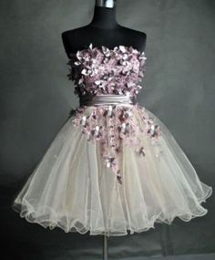 White tulle dress with pink sparkles all around the bodice and silver flower accents