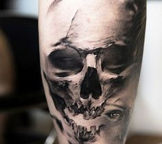 Perfect realistic black and gray Skull tattoo motive by Niki Norberg
