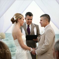 A canopy of white chiffon fabric marked the altar for the beach ceremony.