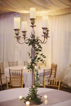 Love the tall candlesticks with the vines as centerpieces