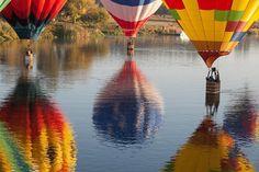 Photo by @erickruszewski: Several #hotairballoons float on the water of the Yakima River in #Washington. by natgeocreative