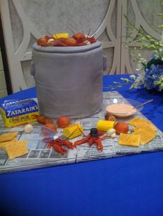"~Grooms cake at Louisiana wedding. Everything here is edible including the Zatarain's box! The corn, potatoes, crackers, crawfish, boiling pot, Zatarains, and even the ""dip"" is all made out of fondant."