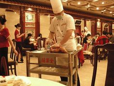 Quanjude Restaurant Beijing - opened in 1864 -- the head chef came and carved for us our duck -- Oh my!