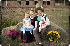 alice in wonderland themed family portrait. HAHA. so cute. too bad i won't be popping out any little blonde alice's...