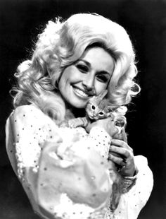 The absolutely fabulous Dolly Parton. With a cat!