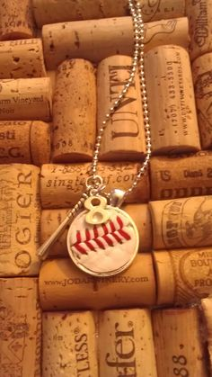 REAL Baseball or Softball Necklace with Large Bat Charm AND CUSTOMIZED team number by DimplesAndCreativity on Etsy https://www.etsy.com/listing/217957747/real-baseball-or-softball-necklace-with