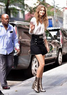 Love Gigi Hadid's mini skirt and metallic boots