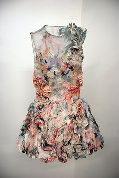 The textiles that were created in this are on point! Looks as though it is more of a piece of art then a wearable dress.