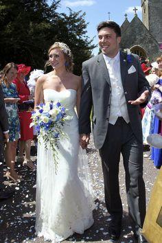 Crystal blush calla lily, avalanche rose, blue delphinium, hydrangea and eucalyptus bridal bouquet