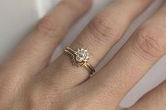 0.25 Carat Oval Diamond Ring With Halo Diamond Crown by MinimalVS