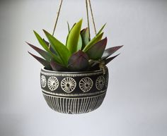 This hanging planter is wheel thrown and hand carved. This little cutie is made to order. Measures about 6X4 inches and does not include a drain hole. Planter comes with natural high quality hemp cord for hanging.