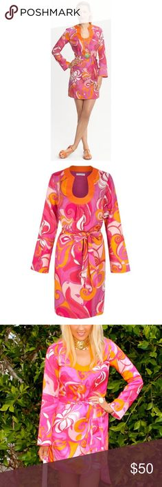 {Trina Turk} for Banana Republic Swirl Tunic Dress Turk's Pink Swirl Printed Bonita Tunic Dress ($120) is the perfect example of the designer's ability to flawlessly meld Midcentury angles and bold, tropical coloring. This bright swirl-print tunic dress has a deep U-shaped neckline with shirring along the bottom, and a self-tying belt. It's perfect for the Lilly Pulitzer fan & can be dressed up or down for summer.  * Condition: Excellent! Banana Republic Tops Tunics