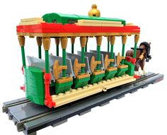 Modeled after classic small town transportation of the turn-of-the-century, the Main Street Trolley slowly trundles toward Sleeping Beauty Castle each morning, bridging the gap between reality and fantasy. Lego Christmas Sets, Lego Gingerbread House, Lego Winter Village, Lego Sculptures, Micro Lego, Lego Trains, Lego Minifigs, Cool Lego Creations, Lego Worlds