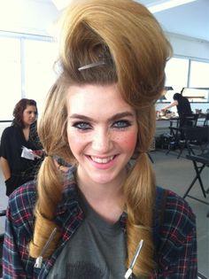 Kinda like a who. Who is that girl? Can she do my hair like that?