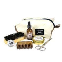 This kit includes everything you need to take care of your beard while at home or on the go. Kit includes:Tchoup Industries Ditty Bag - TanMcClaren Woodshop OG Beard Comb - Dark WalnutOzark Elixir - Backwoods Blend beard oilScoop Deluxe Beard Balm -  Gold LabelMilitary style Boar's Hair Beard Brush -  Natural FirmBeard Trimming ScissorsLucky Bastard Gentlemen's Lip Balm