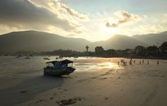 phuong.sg@gmail.com posted a photo:  Seascape of Con Dao Island in southern Vietnam. Sunset on the beach with wooden boat.