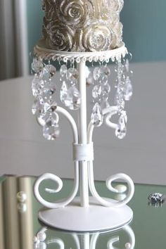 Cream-painted-metal-candlestick-holder-pillar-candle-wedding-dining-table-centre