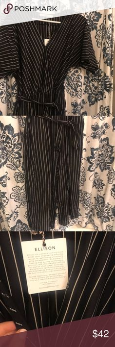Black jumpsuit with white stripes Super cute & classy black jumpsuit with white stripes. Has an adjustable tie belt around the waist, pockets, and a hidden button closure at the bust. You can either leave it open or close it for a more conservative (business) look. This could be worst to an event or to the office! Never worn & tags still attached! vici colletion Other