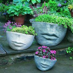 déco de jardin en béton - cache-pot design en forme de visage humain