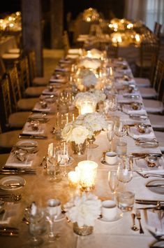 low, white floral arrangements for the tables