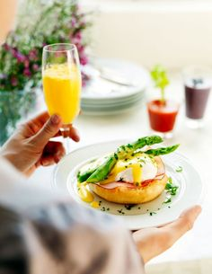 A lovely way to start your day is eggs Benedict for breakfast with fresh squeezed orange juice.