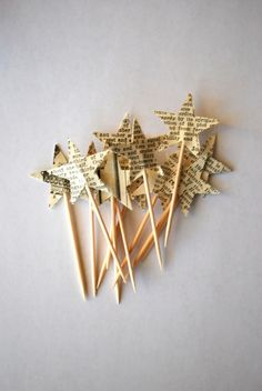 Inspiration: star picks made from vintage paper by thePathLessTraveled. Think of other paper like vintage maps or scrapbook paper and other shapes like a heart.