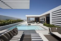 Another view of the pergola over the poolside entertaining are in this CORMAC Residence,© Larry Falke