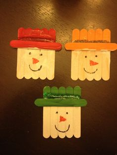Popsicle Stick Snowmen! Excellent fun craft for kids of all ages. Can be done with paintbrushes or finger paint. Older kids can decorate the face themselves while adults can decorate for the little ones.