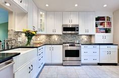 Easy On The Eye Design Of Modern Kitchen Room Ideas With L Shaped White Shaker Kitchen Cabinets Using Absolute Black Granite Tops And Available Kitchen Sink Plus Grey Tile Backsplash Added Recessed Led Lights, Trendy Ideas Of Charming White Cabinets Kitchen Design For Your Home Kitchens Inspiration: Interior, Kitchen