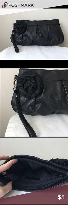 "Black vegan leather wristlet Black vegan leather wristlet - zipper closure - detachable wrist strap - flower design detail - like new! - 12"" x 7"" New York & Company Bags Clutches & Wristlets"