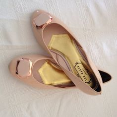 Final price drop! Ted Baker Nude Ballerina Flats Nude pink ballet flats are super adorable. This item is re-listed since I did notice a brown marking or scuff on it. Never worn since the shoes are a bit small and fit snug. Price may run a tad smaller. Please see pic 2 and 3 before purchase. Price is negotiable. Ted Baker Shoes Flats & Loafers