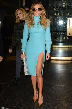 Bedazzling in blue: Jennifer Lopez bared her toned and shapely leg - as well as more detai...