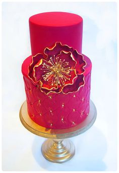 Red and Gold tufted Wedding Cake  www.tablescapesbydesign.com https://www.facebook.com/pages/Tablescapes-By-Design/129811416695