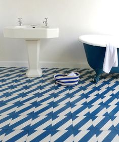 Barbed Tile - Loving this tile!  And a blue claw-foot tub?  This blue bathroom is lovely.