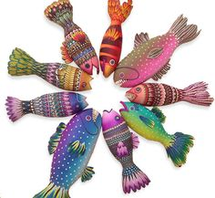 Something fishy is happening with Mary Anne Loveless. Lately this Utah artist has been drawn to making her Poissons series with beautifully patterned scales made from cane slices. Most of her fish are hollow and measure from 10 inches to a foot [. Polymer Clay Fish, Polymer Clay Kunst, Polymer Clay Canes, Polymer Clay Projects, Polymer Clay Creations, Polymer Clay Beads, Clay Crafts, Lampwork Beads, Free Standing Sculpture