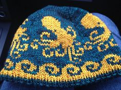 This pattern is for a comfy hat with four friendly octopuses swimming above the band. Colorwork is charted. It is worked in two colors in the round, shaped with decreases around the crown. Any worsted weight yarn will work well. The band of the hat is double-thick ribbing for extra warmth, and extra stretch. An optional tassel or pom-pom gives this hat an added touch of playfulness, just in case the critters aren't enough! Yardage is enough for a hat and matching mitts - perhaps some…