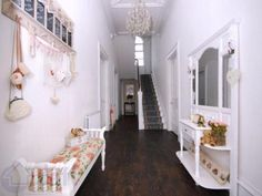Dark Floor withWhite Walls and light decorstions