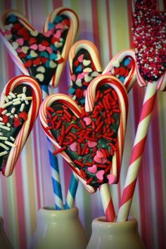 Valentine hearts using candy canes and melted chocolate (and sprinkles).