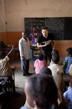Tom participating in a lesson at Ecole Layiya where UNICEF supports children's education. {Tom Hiddleston visits Guinea for UNICEF :: Harper's BAZAAR}